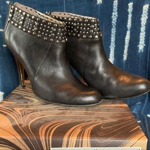 Black ten baker booties with studded detail